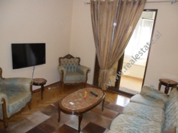 Apartment for rent near Myslym Shyri Street in Tirana. Situated on the 4-th floor in an old buildin