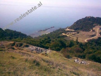 Land for sale in Lalzit Bay. The land lies in a hilly area, about 300m away from the beach. It has a