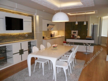 Duplex apartment for rent in Bajram Curri Boulevard in Tirana. It is situated on the last two floors