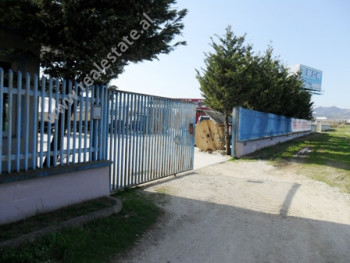 Land and warehouse for sale near Serrat e Xhamit area in Tirana.