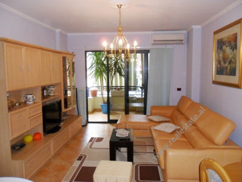 Two bedroom apartment for rent in the beginning of Komuna Parisit Street in Tirana. The apartment i