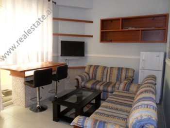 Apartment for rent near Peti Street in Tirana. It is situated on the ground floor in a new building