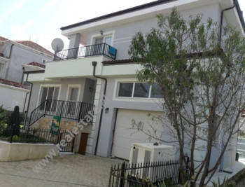 Modern villa for rent near Xhaferr Shaba Street in Tirana.