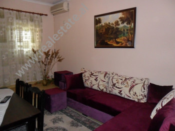 Apartment for rent in Reshit Collaku Street in Tirana. It is situated on the 5-th floor in an old b