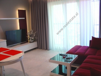 Modern apartment for rent in Devish Hima Street in Tirana. It is situated on the upper floors in a