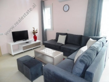 Apartment for rent at the beginning of Dritan Hoxha Street in Tirana. It is situated on the