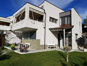 Villa for rent in Lunder, part of a modern villa's compound.