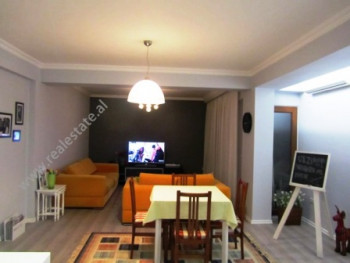 Apartment for rent in Bllok area in Tirana. The apartment is situated on the eighth floor of a new