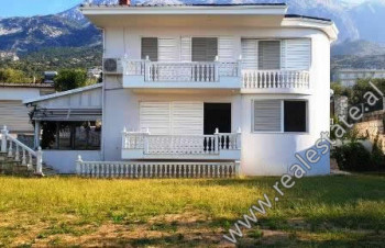 Two storey villa for sale in Dhermi. It offers total land area of 1000m2 and total construction are