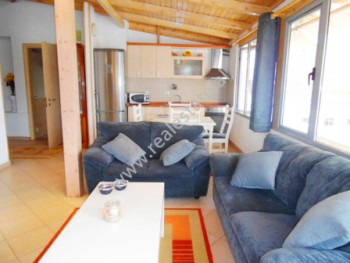 Attic apartment for rent in Zef Jubani street in Tirana.  The apartment is situated on the 12th fl