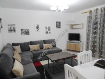Two bedroom apartment for rent in Myslym SHyri street in Tirana. It is situated on the third floor