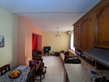 Two bedroom apartment/store for sale in Muhamet Gjollesha street in Tirana, Albania.
