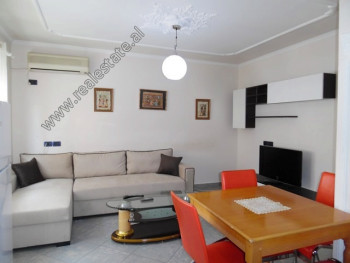 Two bedroom apartment for rent in Myslym Shyri Street in Tirana. It is situated on the 5-th floor o