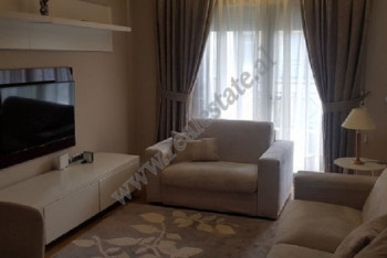 Apartment for rent in Liqeni i Thate area in Tirana.  It is located on the 5th floor of a new buil