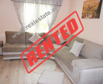 Two bedroom apartment for rent in Reshit Collaku Street in Tirana.  The apartment is situated on t