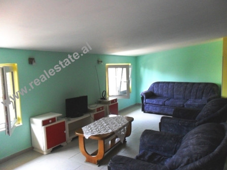 Attic apartment for rent near Myslym Shyri Street in Tirana.