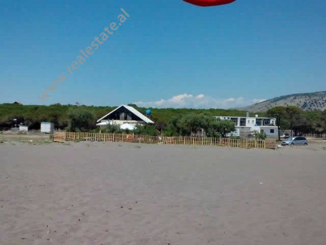 Land for sale with a wooden house in Velipoja Beach in Albania. The land is located in Pulaj on the