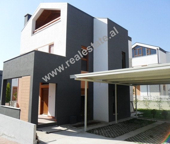 Three storey villa for rent in a residential complex behind TEG in Tirana. The villa is located in o