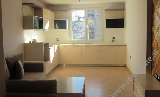 Apartment for rent in Myslym Shyri Street in Tirana.It is situated on the 5-th floor in an old build