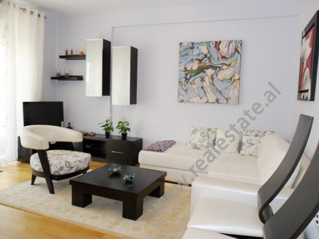 Modern apartment for rent close to Artificial Lake in Tirana. It is located on the 4-th floor in a