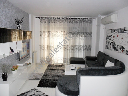 Modern apartment for rent in Komuna Parisit area in Tirana. It is situated on the 5-th floor in a n