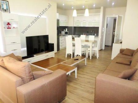Apartament 3+1 me qera prane rruges Asim Vokshi ne Tirane. Ndodhet ne katin e 10-te te nje pallati