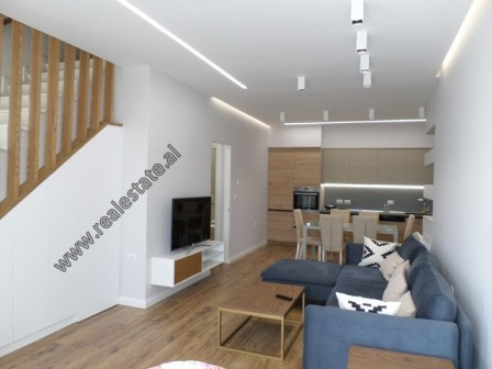 Modern duplex apartment for rent in Kodra e Diellit Residence in Tirana.  It is located on the fir