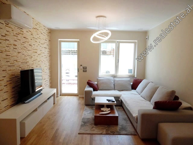 Two bedroom apartment for rent in Eduard Mano Street in Tirana. It is located on the 3rd floor of a