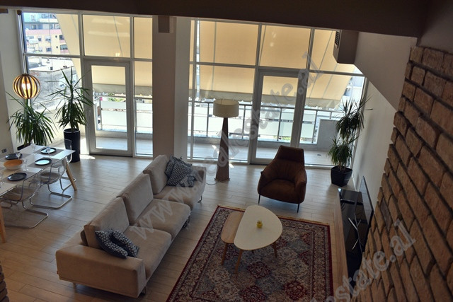 Duplex apartment for rent in Beqir Luga street in Tirana.  The apartment is situated on the 7 and