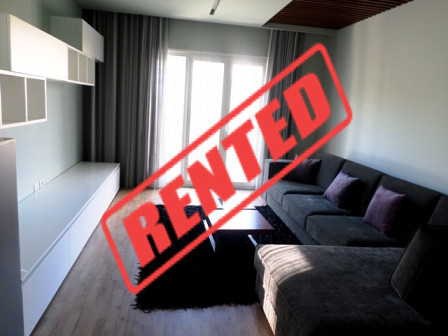 Three bedroom apartment for rent close to Artificial Lake in Tirana.  It is situated on the 4-th f