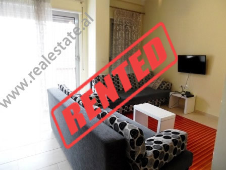 Apartment for rent close to Kavaja Street in Tirana.  It is situated on the 4-th floor of a new bu