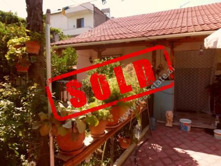One storey villa for sale in Ilmi Aver Street in Tirana.  The villa is located in quiet area and h